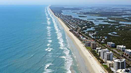 Atlantic Ocean and Mosquito Lagoon III, NSB from the Aerial New Smyrna Beach collection by Russell C Tucker